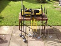 Assortment of adults and children's golf clubs