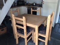 Pine dining room table and four matching chairs