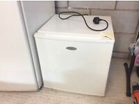 Haier table top refrigerator with small freezer compartment.