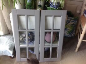 TWO GREY KITCHEN CUPBOARD DOORS ,THAT I WAS GOING TO MAKE INTO A COFFEE TABLE ,OR PUT PICTURES IN