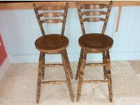 2 dark pine bar stools