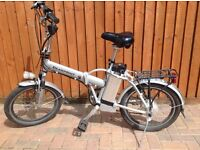 Electric folding bike 36 v battery. Good condition. Includes second bike for spares or repair.