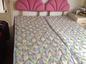 Two single beds pink padded headboards drawers underneath hardly used