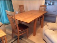 G Plan oak extending dining table and six ladderback chairs