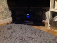 Black TV stand with shelf