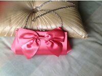 Clutch type handbag - peach/coral satin type material