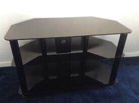 Smoked glass tv stand suitable for a 32 in tv in good condition