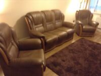 Three piece Bardi Italian leather suite in new condition, light coffee with oak trim.