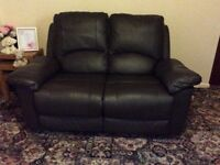 Two seater sofa dark brown recliner not leather very good condition