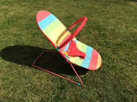 'Cosatto' rainbow coloured baby boucer chair