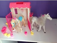 Barbie stable with two horses and accessories.