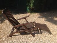 A pair of wooden steamer chairs Painted dark oak. Original design. Very comfortable with foot rests.