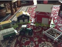 Wooden farmyard, tractor and animals