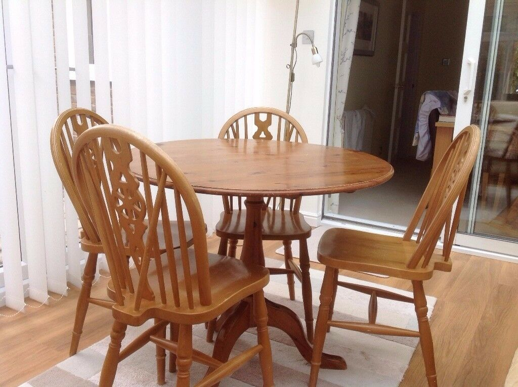 Pine round wooden table and 4 chairs
