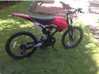 Full suspension mountain bike with motobike