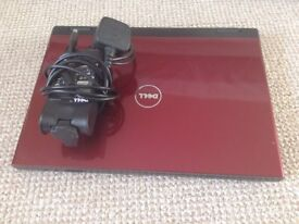 Red Dell Laptop and charger