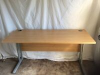 Cantilever desk. Pale wood top with grey metal legs