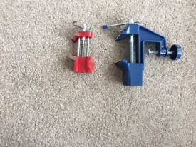 Two small vices/clamps