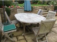 Extending garden table and 6 chairs plus 6 cushions