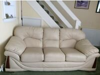 Leather settee, two chairs and footstool