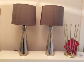 A pair of decorative table lamps also a single table lamp