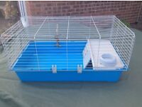 Indoor guinea pig cage with nest area. Easy to keep clean
