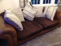 2 tetrad large degas sofas in brown leather and brown material seat and back with striped cushions