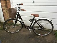 Ladies Raleigh bike with basket.