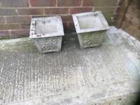 2 heavy stone planters