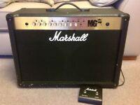 Marshall MG 100fx dual speaker guitar amplifier.