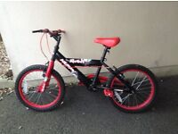 Boys red huffy bike very good condition