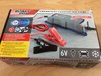 Car / batterey charger new in the box