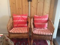 Two small Cane chairs with seat pads and back cushions