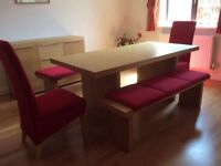 Dining table with chairs and benches