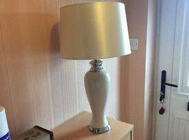 Cream and silver table lamp