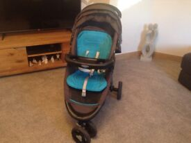 Graco three wheel buggy with one stap pull to fold also rain cover