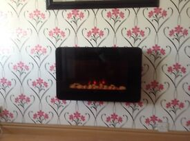 Wall mounted electric fire with remote control . Hanging bracket&screws included.