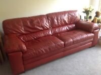 Two leather sofas and stool