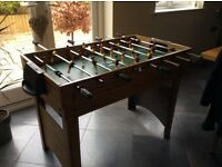 Football table with pool table