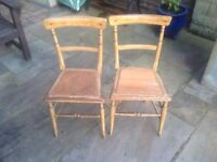 A pair of antique bedroom chairs