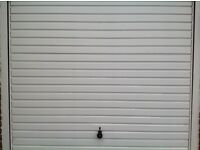 "White Steel retractable garage door with frame 6 months old 7ft wide by 6ft 6"" excellent Condition"