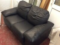 Two seater black leather sofa, vgc could deliver