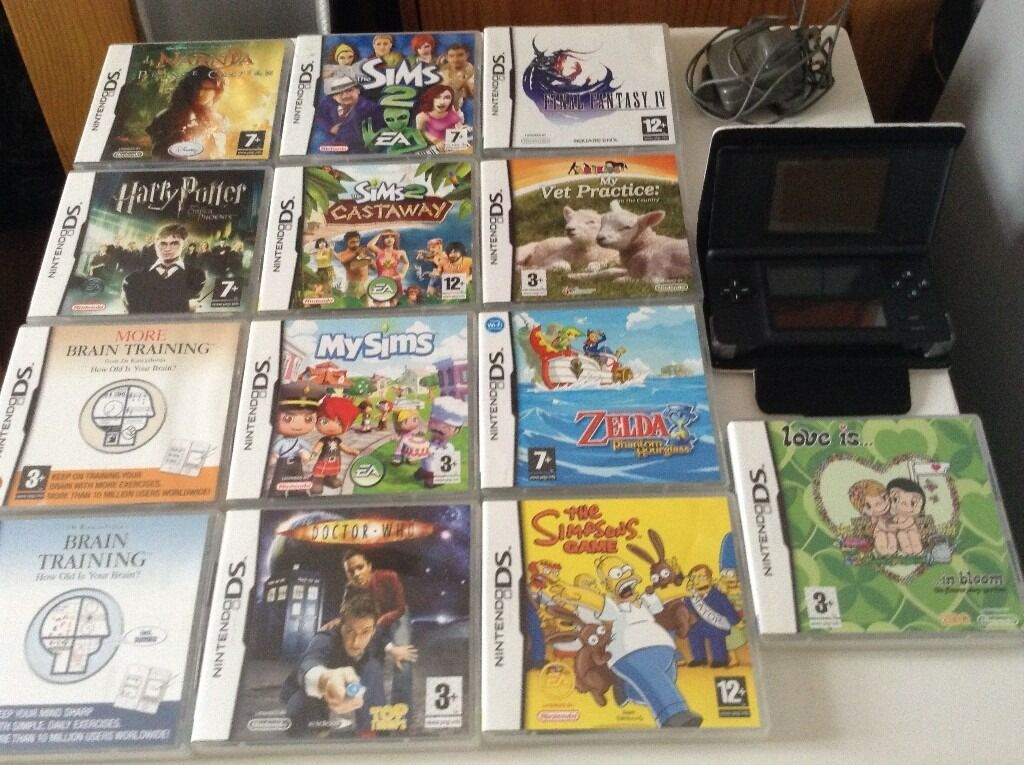 nintendo ds console and assortment of games