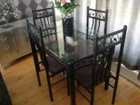 Glass Top Dining Table and Four Chairs