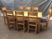 Oak extendable table and 8 leather seated chairs