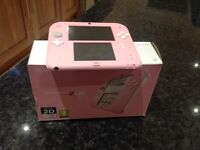 Pink Nintendo 2DS with game and case