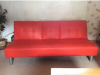 Red Faux Leather Sofa Bed with silver legs.