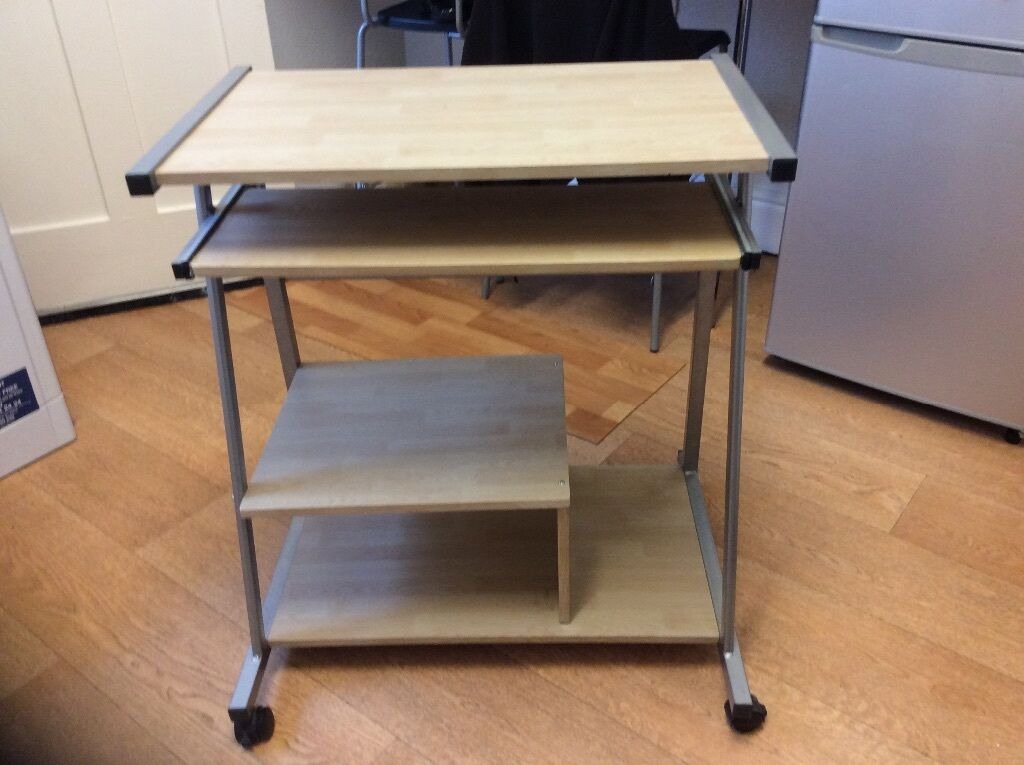 A 2 Tier Computer Desk As New 1 Slide Out Shelf On Casters