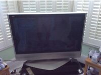 37 inch Panasonic Viera television for sale with stand. Discount for buying together.