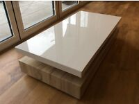 Coffee table, excellent quality, reassuringly heavy with subtle storage
